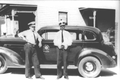 Stein and Lustenburg next to a 1936 Packard